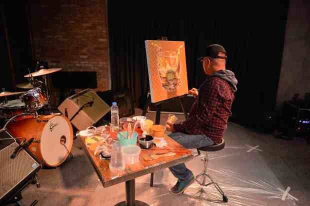 Award-winning local artist Archie Oclos interpreting the complexity of whisky in a live painting session.jpg