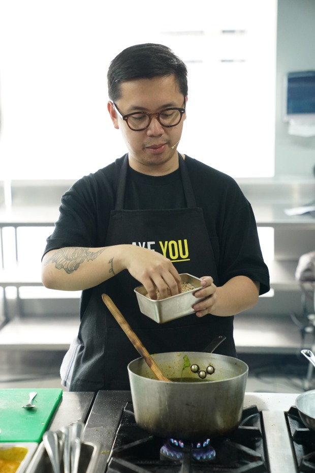 Chef Nicco Santos teaches his students how to innovate traditional dishes.JPG
