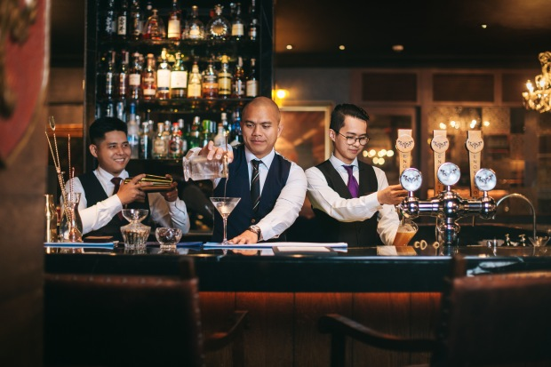 Beverage Manager Federico Deang with his team.jpg